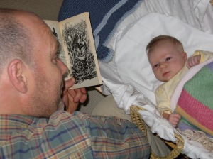 Reading to Grace when she was probably too young to know what was going on.