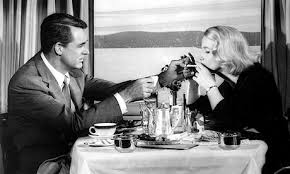 Cary Grant and Eve Marie Saint get acquainted in the dining car in North by Northwest.