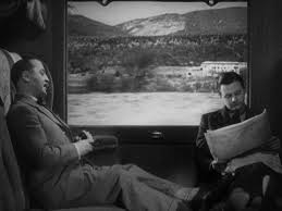 Charters and Caldicott catch up on the Test match in their carriage in The Lady Vanishes.