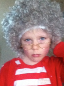 My daughter tries on her granny wig and glasses before her school play.