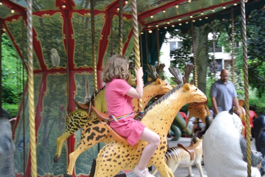 Grace on the merry-go-round in the Jardin des Plantes.