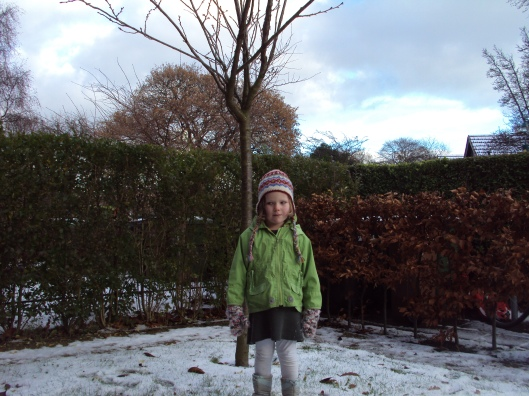 Grace in our front garden in the snowy winter of 2010.
