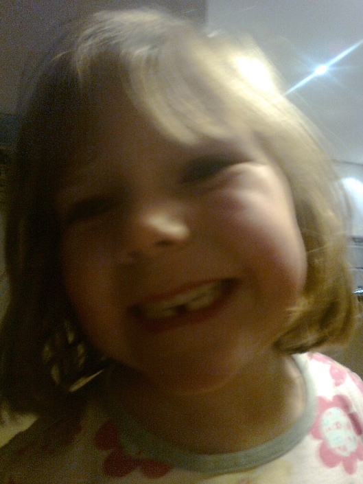 Grace lost her first tooth in 2010.